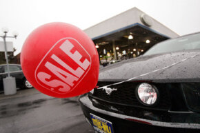 """Image Gallery: Sports Cars A """"sale"""" balloon advertises a special price on a Mustang at a Ford dealership in Tacoma, Wash. See more pictures of sports cars."""