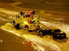 The most important part to car towing safety is, of course, proper driving skills. Here, a tow truck pulls a car from the flooded outbound lan of the Dan Ryan Expressway in Chicago, Ill.