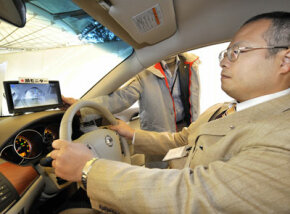 A Nissan engineer demonstrates his company's driver alert system in Tokyo in 2008. See more car safety pictures.