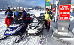 Even these snowmobile drivers know it's best to keep your gas tank full during the winter.