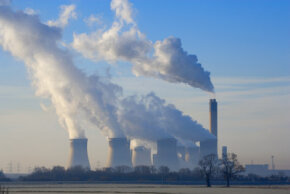 Steam and smoke are emitted from a coal-fired power station in the England. See more green science pictures.