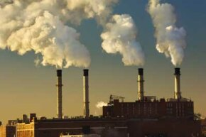 Smoke and steam vapour from electric power station in New York