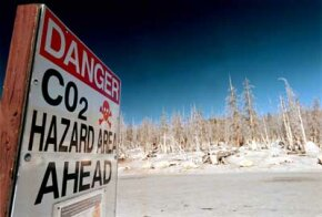 A danger sign warns visitors of high levels of carbon dioxide near Horseshoe Lake in California. The lethal gas is produced by molten magma, which rises to the earth's surface.