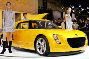 "Volkswagen unveiled its new concept car, the ""Eco Racer,"" in 2005. The car featured a carbon fiber body. See more small car pictures."