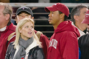 Tiger Woods and his wife, Elin Nordegren, at a sporting event on Nov. 21, 2009 -- just days before the cheating scandal broke