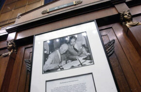 A photo of President Eisenhower signing the Interstate Highway Act hangs under the seat of House Transportation and Infrastructure chairman Don Young (R-Alaska).