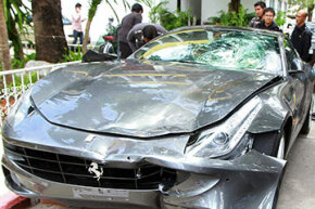 This Ferrari was involved in a hit-and-run accident. The driver may be able to take a casualty loss deduction for damage on his income tax form.