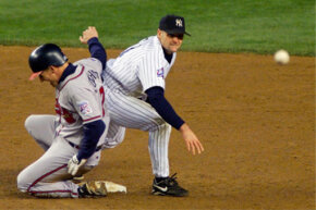 New York Yankees second baseman Chuck Knoblauch (R) throws a pitch to first base to complete a double play during the 1999 World Series. Luckily for Knoblauch, the yips didn't plague him during that particular play as they had all year.