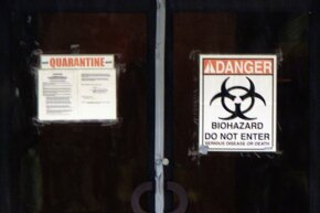 Biohazard stickers at the American Media Center in Boca Raton, Florida, warn visitors away after several workers at the building were exposed to anthrax. One would later die.