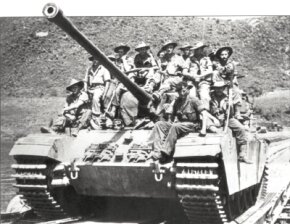 An early Centurion Mark 2 Battle Tank, armed with the 17-pounder gun and loaded with Australian troops, crosses the Imjin River during the Korean War. See more tank pictures.