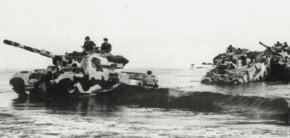 These British Centurion MBTs wade ashore in the Middle East during an exercise. Thirteen nations have purchased the British Centurion.