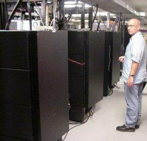 Drew McKeen standing next to the SGI Onyx machines