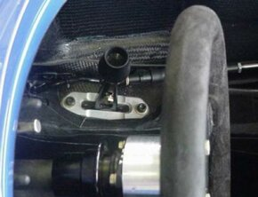 This photo shows the gear shift lever of the Motorola Champ car featured in How Champ Cars Work. The gear shift lever is to the driver's right. The car has a sequential six-speed transmission, so instead of the H-pattern seen on a normal manual transmission, the shifter moves in a straight line.