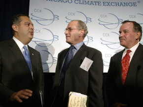 Dr. Richard Sandor (C) speaks with the U.S. Secretary of Energy and Chicago's mayor shortly after the CCX held its first auction for emission allowances.