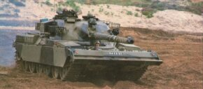Some British Chieftain Main Battle Tanks have aluminum bulldozer blades mounted on the hull front for preparing defensive positions and clearing roads. See more tank pictures.