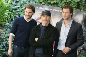 """Ron Howard in Italy promoting his film """"Rush"""" with actors Daniel Bruhl and Chris Hemsworth in September 2013."""