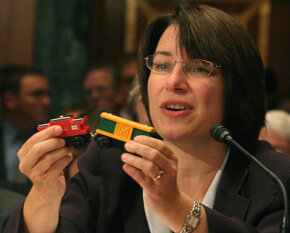 The numerous toy recalls attracted the attention of Congressional leaders. Here U.S. Senator Amy Klobuchar holds a toy with lead paint at a Senate subcommittee meeting about toy safety.