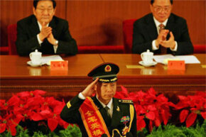 Yang Liwei, China's first astronaut in space, salutes before giving a speech during a 2007 meeting marking the 80th anniversary of the founding of the People's Liberation Army.
