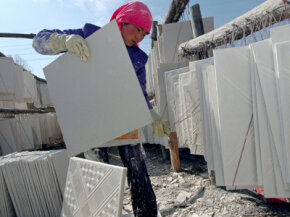 A local worker making drywall in Huzhu County of Qunghai Province, China. See more home construction pictures.