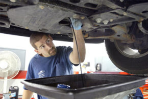 Automotive service technician Steve Loverme works on a vehicle at Bredemann Chevrolet in Park Ridge, Ill.