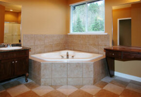 WARNING! A luxurious soaker tub like this one can drink up more than 120 gallons of hot water.