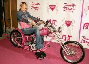 Paris Hilton poses on her $250,000 custom chopper.
