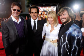 "The introductory scene of ""Tropic Thunder,"" featuring Tom Cruise, left, Ben Stiller, second from left, and Jack Black, right was shot continuously. They are shown here at the premiere with Dreamworks CEO Stacey Snider. See more movie making pictures.­"