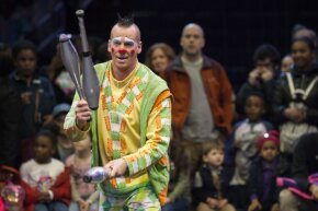 Jugglers can perform with a many different objects, including bowling pins.