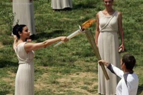 The lighting of the Olympic torch in 2012. Destination: London. See more Olympic pictures.