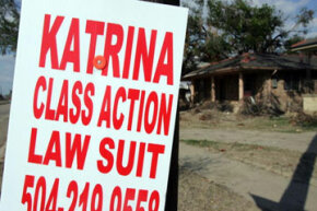 A sign advertises the advent of a class action lawsuit in New Orleans shortly after Hurricane Katrina hit the city in 2005.