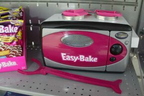 The current Easy-Bake Oven bears little resemblance to the model with the cooktop and front-loading oven that caught so many little fingers.