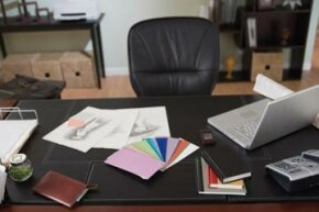 Keep your home office tidy by getting rid of unnecessary papers and clutter. See more home office decor pictures.