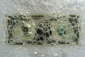 That dollar doesn't have to go down the drain. See more money pictures.