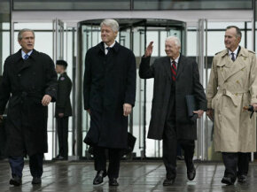 U.S. President George W. Bush (from left) and former presidents Bill Clinton,