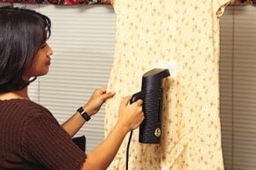 Garment steamers let you get the wrinkles out of your clothes while they're still on the hanger.
