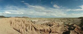 Although a variety of clouds pass over the Arizona's Painted Desert, little rain falls.