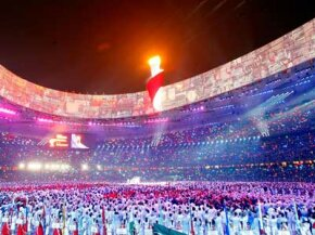 Downpours didn't snuff out the torch during the opening ceremony of Beijing's 2008 Olympic Games. Was it a matter of good luck or even better science? See more ­weather pictures.