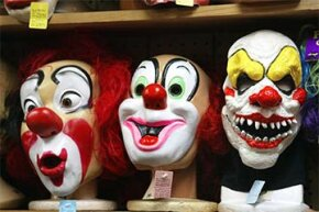 Clown masks, ranging from cheery to evil, are displayed at the Fantasy Costumes HDQ store in Chicago prior to Halloween.