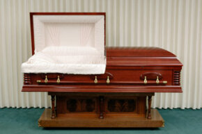 A hardwood, plush-lined, modern coffin