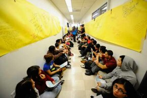 Students and faculty members staged a sit-in in front of the president's office at California State University, Northridge, protesting proposed budget cuts in 2011. Several theories have been proposed for the high increase in college costs. See more college pictures.