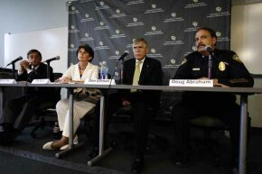 University of Colorado Anschutz Medical Campus Dean of the Graduate School Barry Shur (left), Executive Vice Chancellor Lilly Marks, Chancellor Don Elliman and Police Chief Doug Abraham speak during a 2012 news conference in Aurora, Colo.