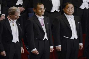 Some of the 2012 Nobel Prize winners stand during the awards ceremony in Stockholm. It costs colleges a lot to fund the professors who win these prestigious prizes and costs are often passed down to students.