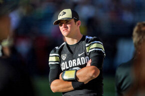 Tyler Hansen, quarterback for the University of Colorado, watches after being taken out of the game against the University of Oregon on Oct. 22, 2011, after sustaining a concussion. Experts say two concussions occurring closely together may be life threatening.