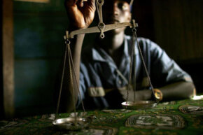 A gold merchant in Bunia in the Democratic Republic of the Congo, where many mines are under the control of violent militias, rebels and other armed groups.