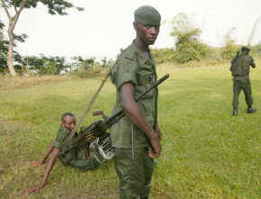 In February 2005, Congolese Green Beret soldiers patrol the Congo River in Kinshasa.