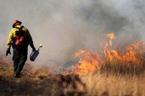 Volunteer Jonathan Hallinan monitors a controlled burn at Appleton Farms in Ipswich, Massachusetts.