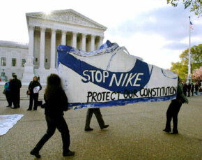 Protest in Washington, D.C., in 2003 over Nike's assertion that as an artificial person, it has a right to use deception under the First Amendment protection of free speech.