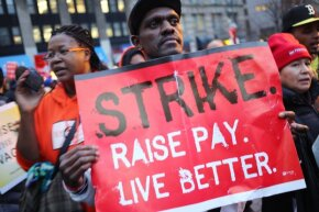 Striking fast-food workers are joined by supporters, union members and activists at a rally in New York City's Foley Square to demand an increase in the minimum wage to $15 an hour.
