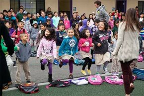 The entire student body at Rocketship SI Se Puede charter elementary school dances during 'launch,' the all-school morning program, in San Jose, California in 2014. See school lunch pictures.