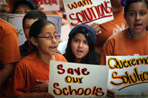 Students and parents protested funding and staff cuts outside the office of Chicago Board of Education in 2013. Earlier that year, Chicago Public Schools announced it would close more than 50 elementary schools to rein in a $1 billion budget deficit.